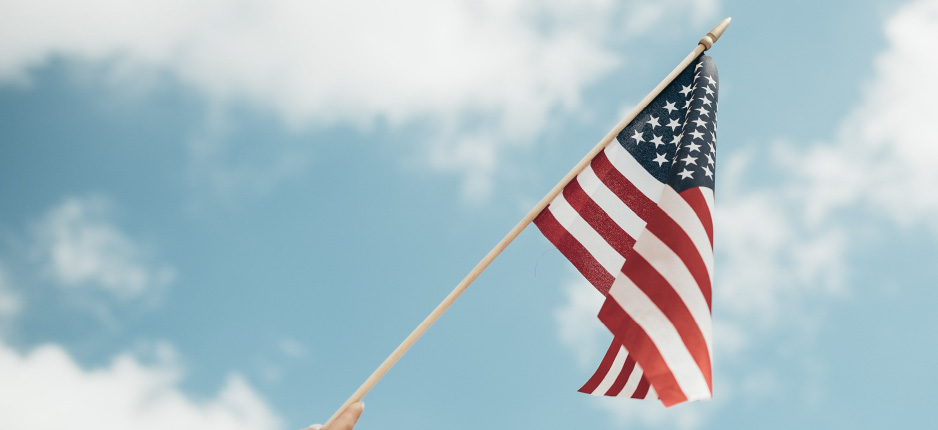 american flag with sky as the background