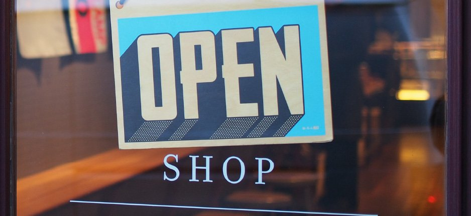 open sign in front of a store window