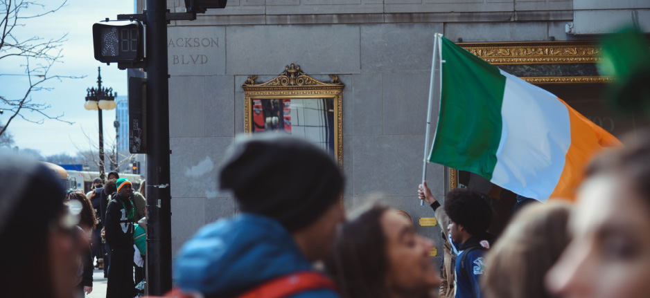 person waving irish flag