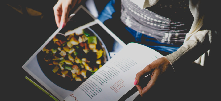 woman holding recipe book