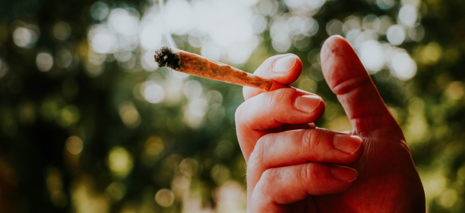 man holding a joint
