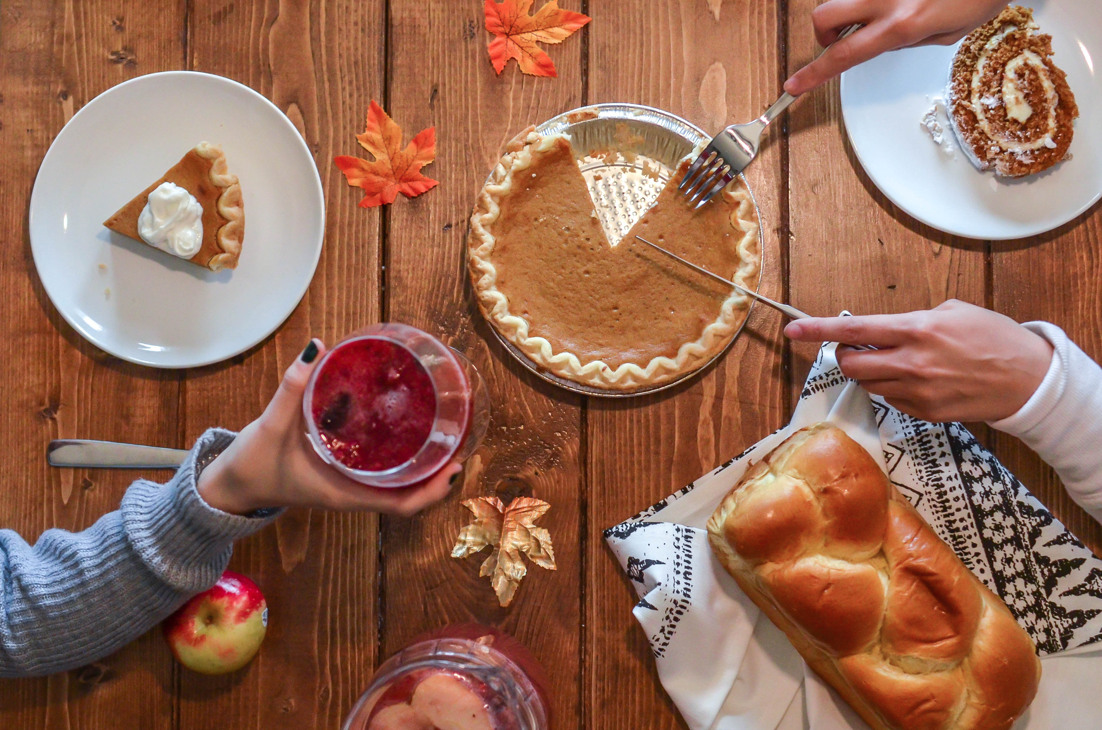 thanksgiving feast on brown wooden table