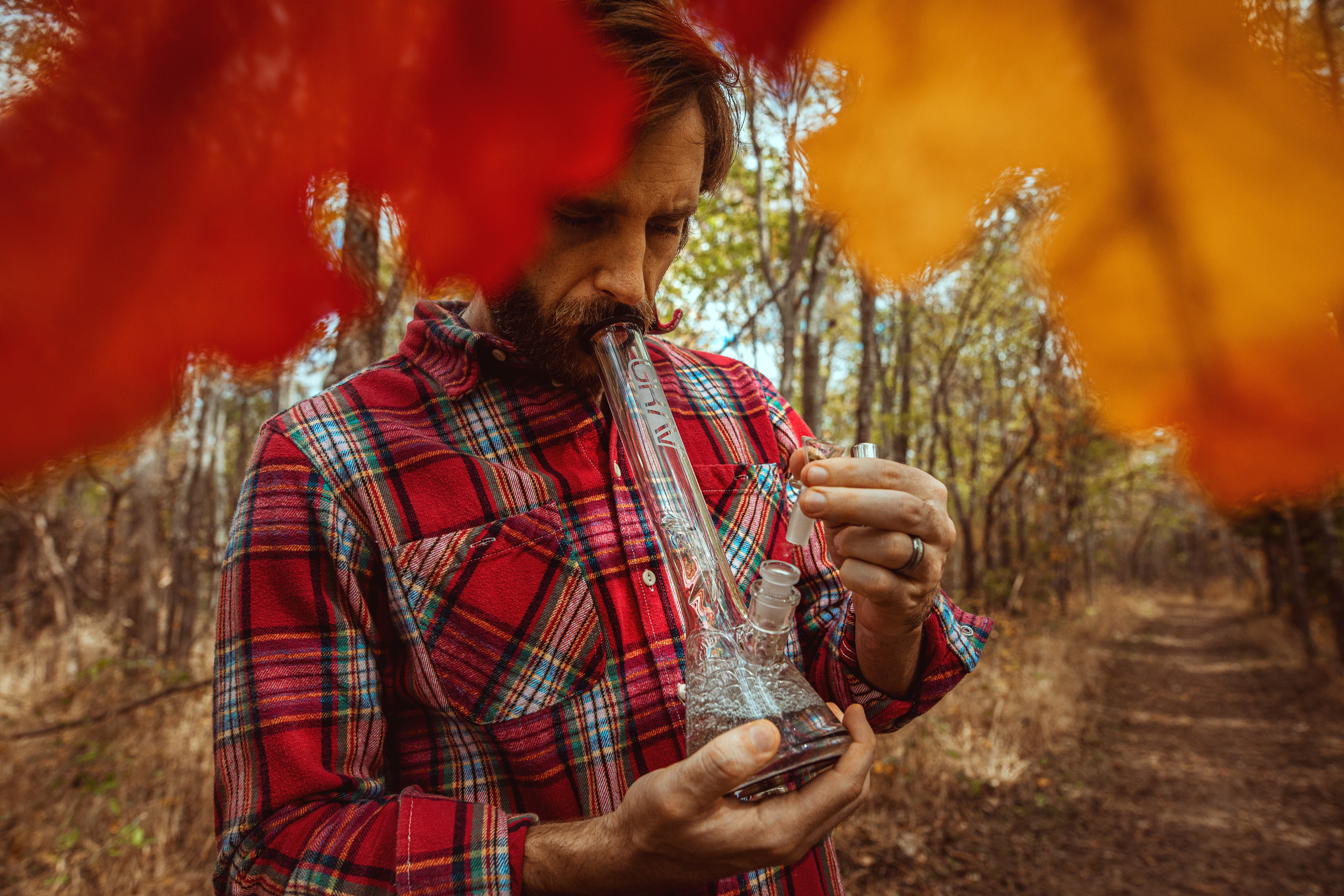 male smoking cannabis from a bong