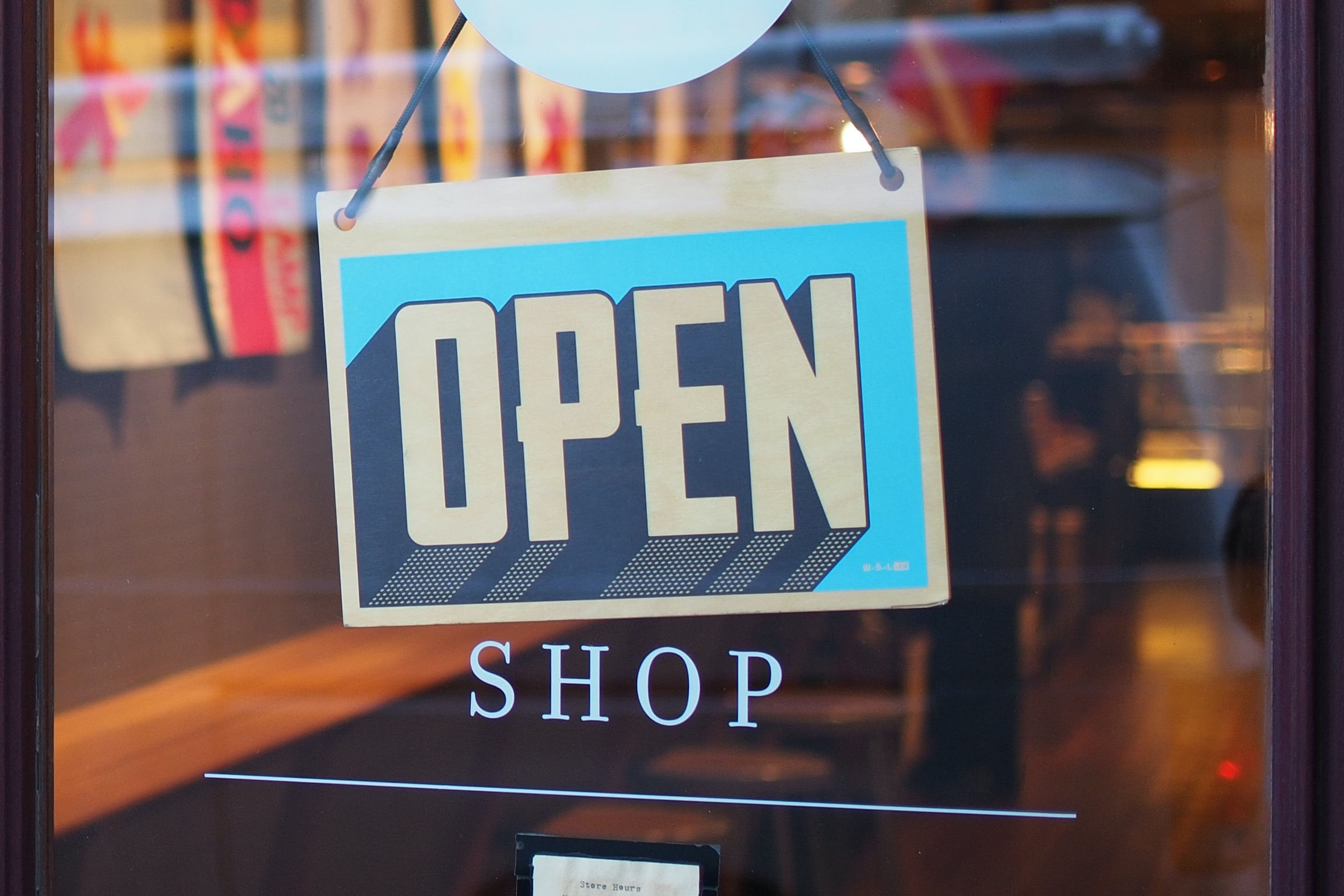 open sign in the front window of a store