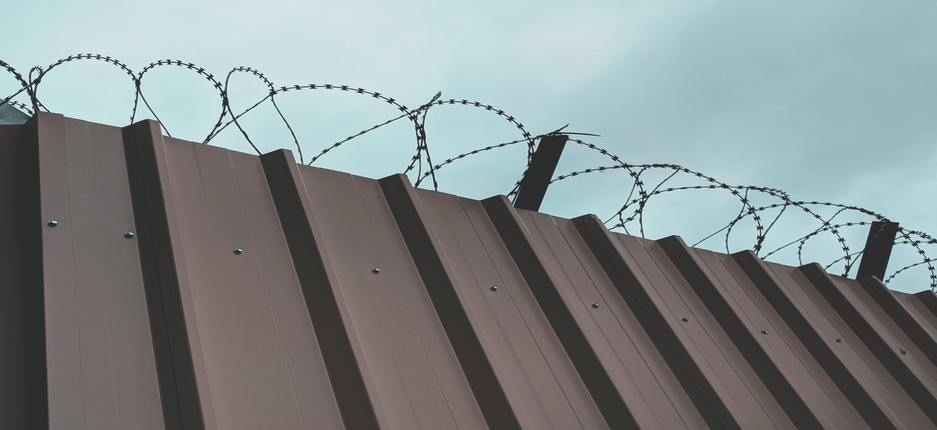 prison building with barbed wire